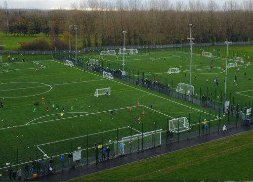 Two 4k Football pitches with football players playing