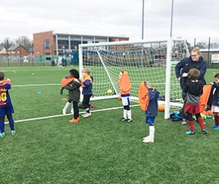 Children at Vauxhall Sports Club playing football