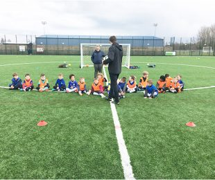 Children listening to the coach at Vauxhall Sports Club