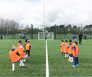 Children training and learning how to play football at Vauxhall Sports Club