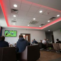 People watching football in the Vauxhall Sports Cafe