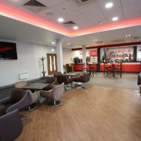 Tables and chairs in the cafe at Vauxhall Sports Motor Club