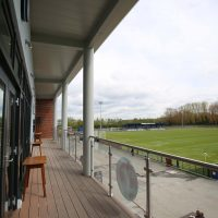Behind the Vauxhall Motors Sports Club showing the balcony and football fields in the background